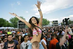 Techno music fans dance to the sounds coming from the stage during the concert of the Loveparade 2008 on Saturday, July 19, 2008, in Dortmund, western Germany.