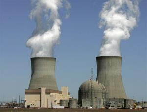 Steam rises from the cooling towers of nuclear reactors.