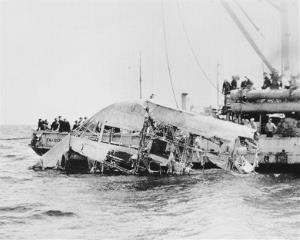 In this April 23, 1933 photo, the wreckage of the naval dirigible USS Akron is brought to the surface of the ocean off the coast of New Jersey. The Akron went down in a violent storm off the New Jersey coast.