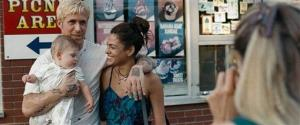 This film image released by Focus Features shows Ryan Gosling and  Eva Mendes in The Place Beyond the Pines.