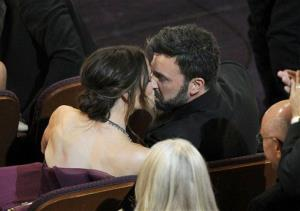 Jennifer Garner kisses husband and director Ben Affleck after Argo is announced the winner for the award for best picture during the Oscars at the Dolby Theatre on Feb. 24, 2013, in Los Angeles.