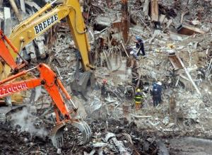 In this Nov. 5, 2001 file photo workers continue to remove debris in the rubble of the remains of the World Trade Center at ground zero.