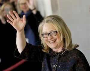 Outgoing Secretary of State Hillary Rodham Clinton waves as she leaves the State Department in Washington, Friday, Feb. 1, 2013, for last time as America's top diplomat.