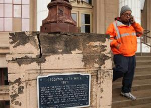 In this Feb. 29, 2012 file photo, a Stockton city worker walks out of city hall in Stockton, Calif.