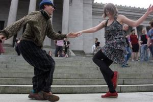 Melissa Petersen and Kevin Buster dance on the steps of the Capitol in Olympia, Wash., Monday, April 1, 2013 to protest a decades-old state tax on dance venues.