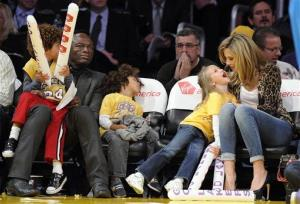 Seal and Heidi Klum watch the Los Angeles Lakers play the New Orleans Hornets in an NBA basketball game with their kids, from left, Henry, Johan, and Helene, Friday, Jan. 7, 2011, in Los Angeles.