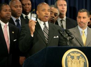 New York State Sen. Eric Adams, center, speaks during a news conference in New York, Friday, June 5, 2009.