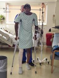 In this photo released by the University of Louisville, basketball player Kevin Ware walks on crutches Monday.