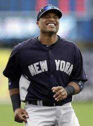 In this March 22, 2013, file photo, New York Yankees' Robinson Cano laughs before a spring training baseball game against the Minnesota Twins in Fort Myers, Fla.