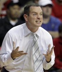 Mike Rice reacts to play during an NCAA college basketball game against Connecticut early last years.