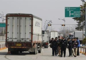 South Korean vehicles turn back after being refused entry to Kaesong.