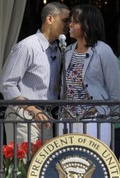 President Barack Obama kisses first lady Michelle Obama as she is introduced at the annual Easter Egg Roll on the South Lawn of the White House in Washington, Monday, April 1, 2013.