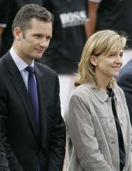Spain's Princess Cristina, right, and her husband Inaki Urdangarin, left, are seen during the Barcelona Open Tennis Tournament Sunday, April 26, 2009.