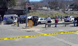 Law enforcement officers and emergency service personnel converge on the scene of the shooting in downtown Williamson, W.Va., Wednesday.