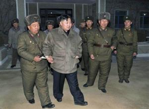 In this file photo, North Korean leader Kim Jong Un, second from left, walks during his visit to a military unit at an undisclosed location in North Korea.