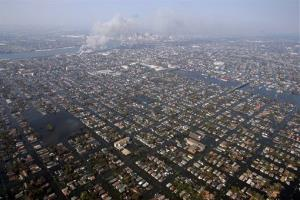 In this Sept. 2, 2005 file photo, homes are surrounded by floodwaters from Hurricane Katrina.