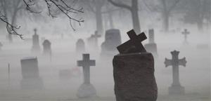Fog descends upon Calvary Catholic Cemetery in a section where the headstones date back to the beginning of the 20th Century Tuesday, Nov. 20, 2012 in Evanston, Ill.