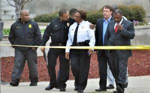 Jackson, Miss. Assistant Chief Lee Vance, center left, comforts Chief Rebecca Coleman, center right, Thursday, April, 4, 2013, after detective Eric Smith was shot and killed.