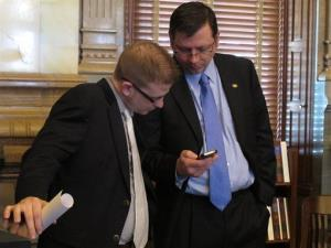 Kansas Senate Majority Leader Terry Bruce, right, consults with his chief of staff, Peter Northcott, before the Senate vote on Friday.