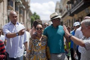 Beyonce and her husband, rapper Jay-Z, right, tours Old Havana as a body guard, left, and tour guide, right, accompany them in Cuba, Thursday, April 4, 2013.