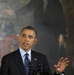 President Barack Obama gestures as he speaks during an Easter Prayer Breakfast in the East Room of the White House in Washington, Friday, April 5, 2013.