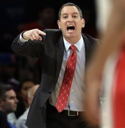 In this March 12, 2013, file photo, Rutgers coach Mike Rice yells out to his team during an NCAA college basketball game against DePaul at the Big East tournament in New York.