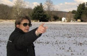 In this photo made on Tuesday, March 26, 2013, Carol Tanzola, president of Friends of Camp Security, points out the property on a 47-acre parcel, located about four miles east of York, Pa.