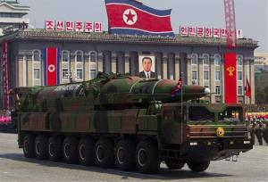 A North Korean vehicle carrying a missile passes by during a mass military parade in Pyongyang's Kim Il Sung Square.