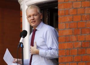 This Aug. 19, 2012 file photo shows WikiLeaks founder Julian Assange making a statement to the media and supporters at a window of Ecuadorian Embassy in central London.