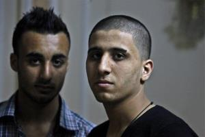 Ayman al-Sayed, 19, right, with his hair cut, and his friend Mohammed Hanouna, 18, left, pose for photo during an interview in Gaza City, Sunday, April 7, 2013.
