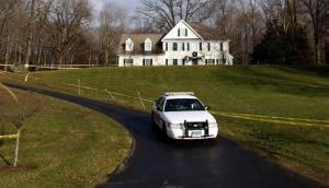 In this Dec. 18, 2012 file photo, a police cruiser sits in the driveway and crime scene tape surrounds the home of Nancy Lanza in Newtown, Conn.