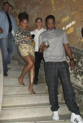 Beyonce, center, and her husband Jay-Z, right, walk down the stairs at La Guarida restaurant in Havana, Cuba, Wednesday, April 3, 2013.