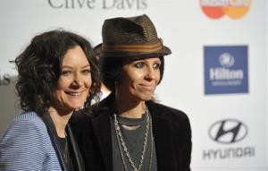 Actress Sara Gilbert, left, and recording artist Linda Perry arrive at the Clive Davis Pre-GRAMMY Gala on Saturday, Feb. 9, 2013 in Beverly Hills, Calif.