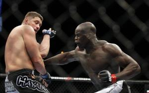 Cheick Kongo, of France, right, punches Matt Mitrione during a mixed martial arts heavyweight bout, Saturday, Oct. 29, 2011, in Las Vegas.