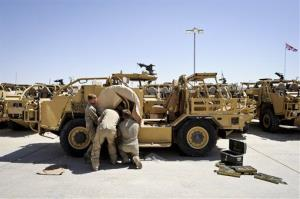 British Army engineers prepare vehicles ahead of a major operation to airlift thousands of tons of military equipment from Afghanistan.