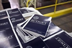 In this April 8, 2013 photo, copies of President Obama's budget plan for fiscal year 2014 are prepared for delivery.