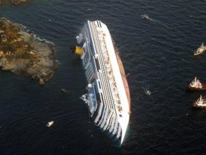 In this Jan. 14, 2012 file photo, the luxury cruise ship Costa Concordia leans on its side after running aground off the tiny Tuscan island of Giglio, Italy.