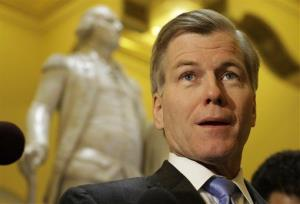 Virginia Gov. Bob McDonnell speaks to the press in front of a statue of George Washington at the Capitol.