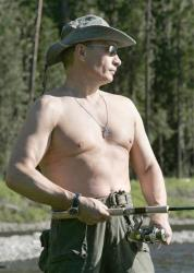Russian President Vladimir Putin fishes in the headwaters of the Yenisey River in 2007, sans shirt, of course.