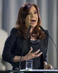 Argentina's President Cristina Fernandez gestures during a presentation of a project to reform the judicial system at the government house in Buenos Aires, Argentina, Monday, April 8, 2013.