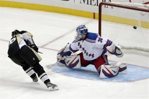Pittsburgh Penguins' Jussi Jokinen scores on the Rangers' Henrik Lundqvist during a shootout on April 5.