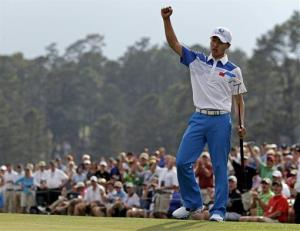 Amateur Guan Tianlang of China celebrates after a birdie putt on the 18th.