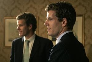 In this July 25, 2007 file photo, twin brothers Cameron, left, and Tyler Winklevoss talk with reporters following a news conference in Boston.
