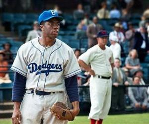 This film image released by Warner Bros. Pictures shows Chadwick Boseman as Jackie Robinson in a scene from 42.