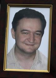 This 2009 file photo shows a portrait of the late Russian lawyer Sergei Magnitsky.