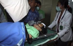 A passenger injured in a plane crash into a hospital in Jimbarn, Bali, Indonesia, Saturday.
