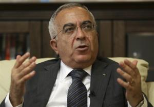 Palestinian Prime Minister Salam Fayyad speaks during an interview with the Associated Press in the West Bank city of Ramallah.