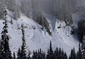 Evidence of sliding snow is seen in steep terrain near a ski area at Snoqualmie Pass in Washington state.