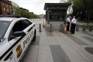 Police tape is stretched across Pennsylvania Avenue near the White House as police closed the street yesterday.