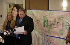 Larry Pott, father of Audrie Pott, reads a statement as Sheila Pott, left, Audrie's mother, looks on during a news conference Monday, April 15, 2013 in San Jose, Calif.